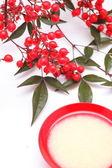 Japanese sweet mild sake and nandina domestica — Stock Photo