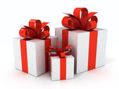 Gift with red ribbons — Stock Photo