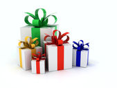 Gifts with color ribbons piled — Stock Photo