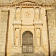 Stock Photo: Door of church in Ucles