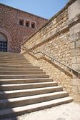 Stone stairs with metal banister — Stock Photo