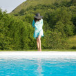 Blue dress woman on pool border — Stock Photo