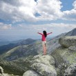 Side embracing woman at the top — Stockfoto