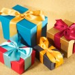 Four colour present boxes — Stock Photo