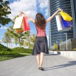 Stock Photo: Happy shopper and skyscrapers