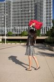 Anger woman throwing suitcase — Stock Photo