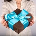 Brown gift white shirt woman — Stock Photo