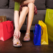 Shopping woman dressing shoes — Foto de Stock