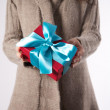 Winter female with red gift — Stock Photo #9580851