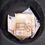 Black hat moneybox — Stock Photo
