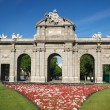 Puerta de Alcala with flowers - Stock Photo