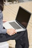 Businesswoman with portable — Stock Photo