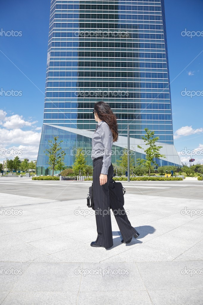 Business woman next to skyscrapers in Madrid city Spain — Stock Photo #9705179