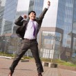 Jumping happy businessman - Stockfoto