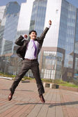 Jumping happy businessman — Photo
