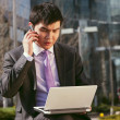 Young businessman talking on mobile phone. — Foto de Stock