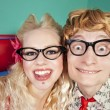 Happy nerdy couple — Stock Photo #8660575