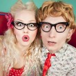Foto Stock: Happy nerdy couple