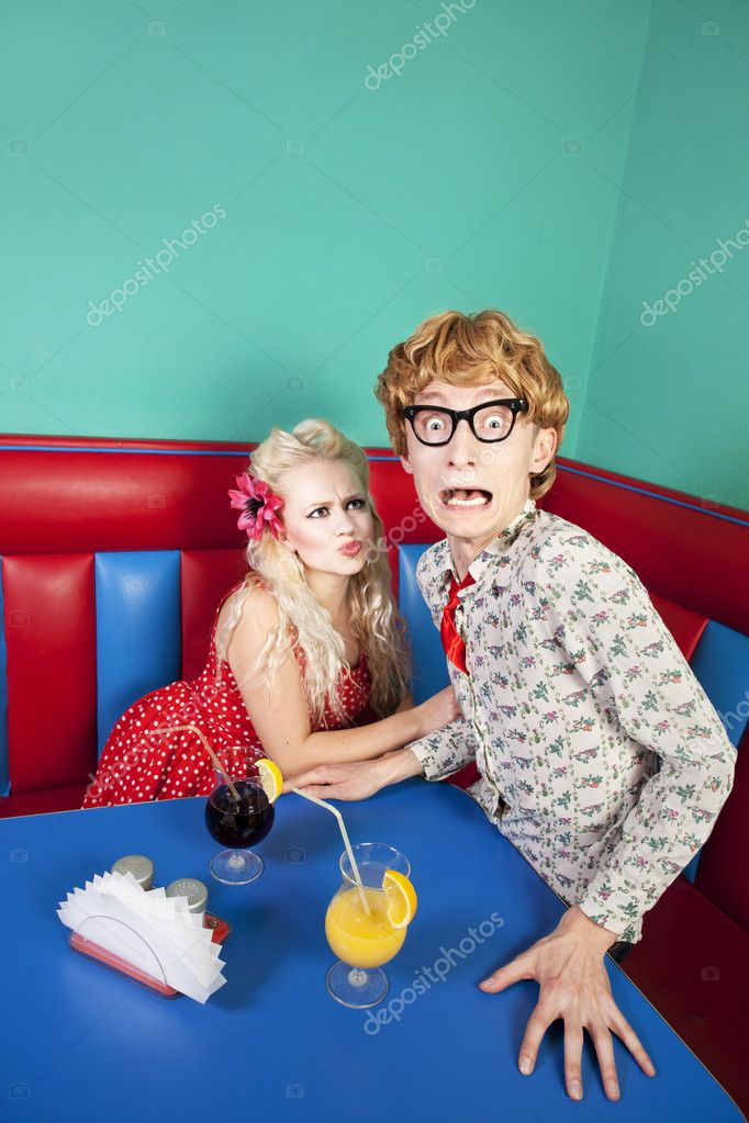 Nerdy guy escaping from his girlfriend — Stock Photo #8660535