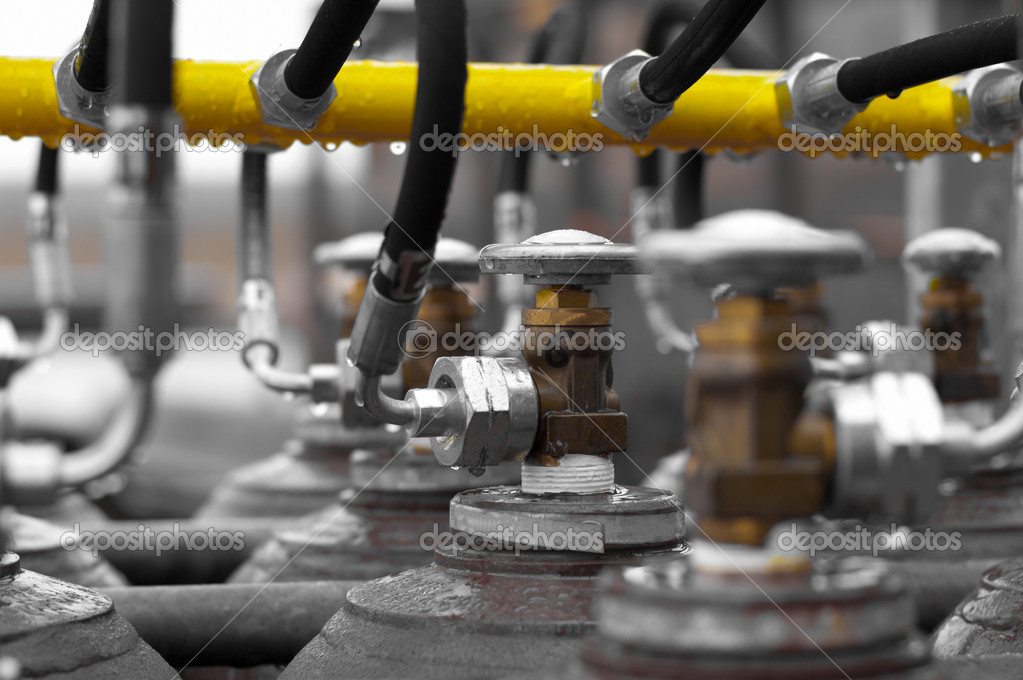 Shallow depth off field picture off manifold valves — Stock Photo #9444520