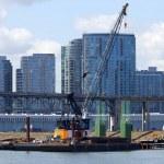 Bridge construction and modern buildings. — Stock Photo