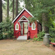 A small red chapel in a forest, Portland OR. — Stock Photo