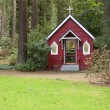 Royalty-Free Stock Photo: A small red chapel in a forest, Portland OR.