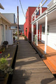 Between floating homes alley way. — Stock Photo