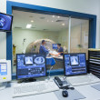 Stock Photo: MRI machine and screens
