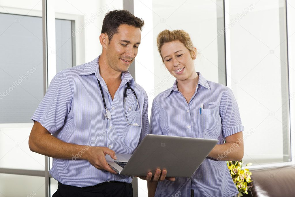 Young doctor talking with attractive nurse — Stock Photo #10642966
