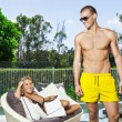 Foto Stock: Young couple in backyard