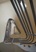 Spiral stairs with metal bannister forming a triangle shape — Stock Photo