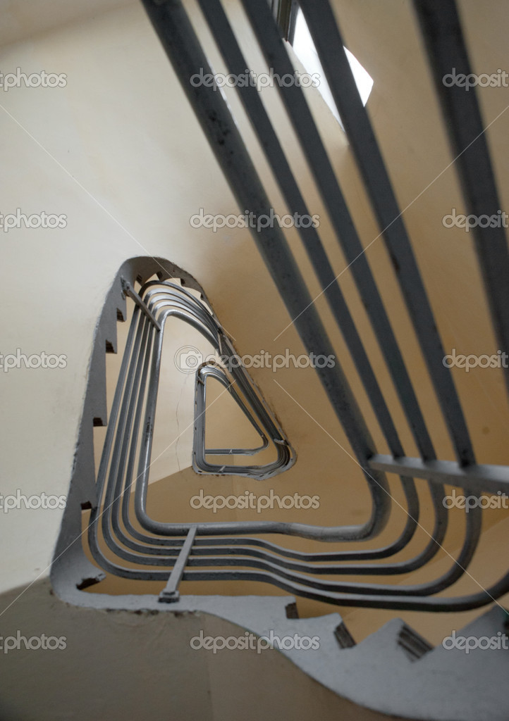 Spiral stairs with metal bannister forming a triangle shape  Stock Photo #9639253