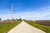 Landsväg - löst grus — Stockfoto