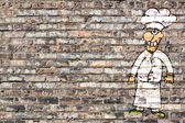 Urban Design) Painted Cook on small restaurant facade — Stock Photo