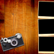 Royalty-Free Stock Photo: Vintage Pictures and Camera on Wooden Old Table