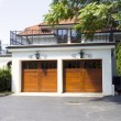 Traditional American Garage With Dark Wooden Door - 