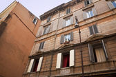 Red curtains Trastevere — Stock Photo