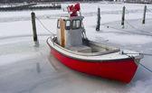 Tiny fishing boat in ice — Stock Photo