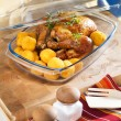 Stock Photo: Roasted chicken in heatproof bowl.