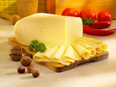 Arrangement with appetizing cheese on the kitchen table. — Stok fotoğraf
