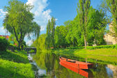 Spring landscape with boat on the Narew river. Pułtusk, Poland. — Stock Photo