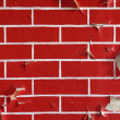 Foto Stock: Old wall with flaky paint. Pattern of bricks.