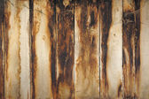 Old wooden background with dust and burnt vertical boards — Stock Photo