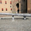 Cannon to defend the castle of the Este family in Ferrara City - — Stock Photo