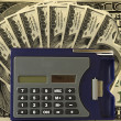 "Stock Photo: ""calculator on dollar"""