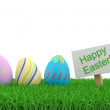 Stock Photo: Decorated easter eggs in the grass. 3D illustation