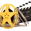Movie film reels and cinema clapper. 3D render - Foto Stock