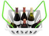 Shopping basket with wine bottles — Stock Photo