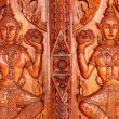 Native Thai style carving, painting on church door in the temple — Stock Photo